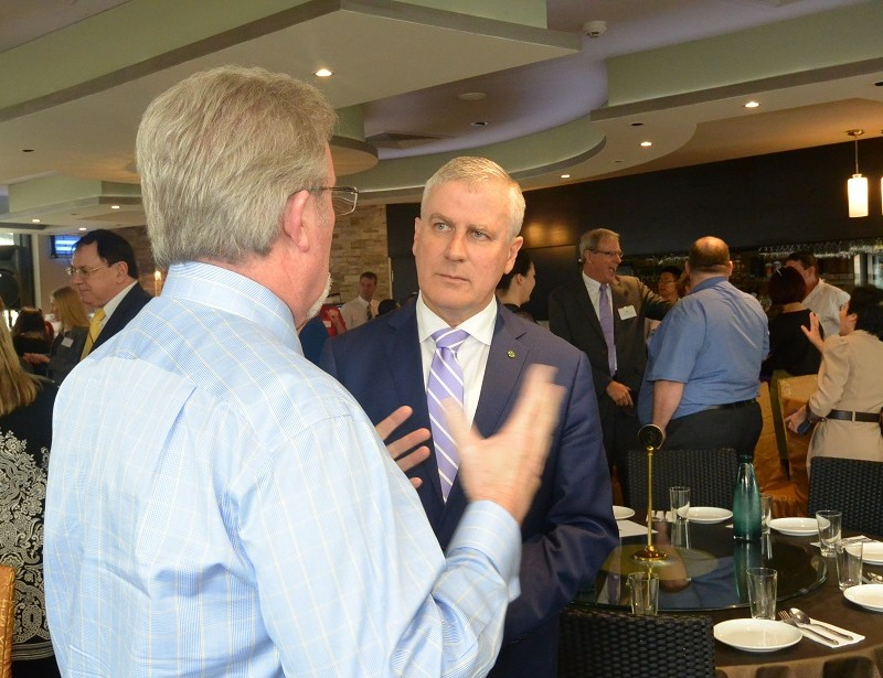 Hon. Michael McCormack, MP listening to small business owner
